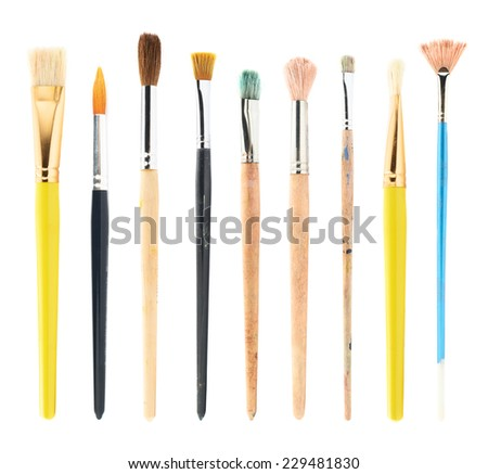 Set of multiple used and new drawing brushes isolated over the white background - stock photo