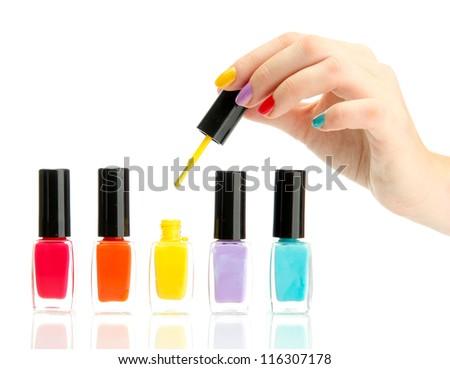 set of nail polishes isolated on white - stock photo
