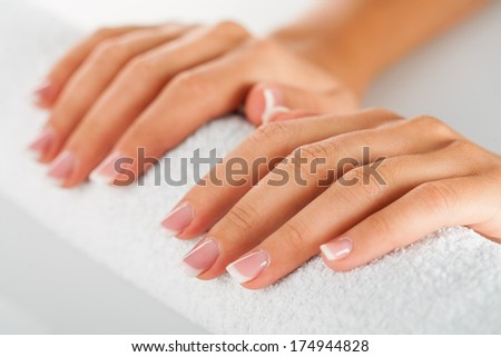 Set of nicely manicured fingernails with french manicure over white background.