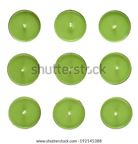 Set of nine green round candles, top view, isolated over the white background - stock photo