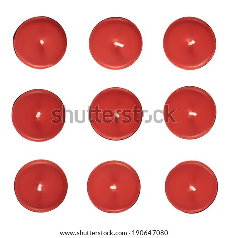 Set of nine red round candles, top view, isolated over the white background - stock photo