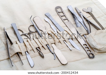 Set of old and vintage surgical instruments: scalpel, scissors, clamp, tweezers and others. - stock photo