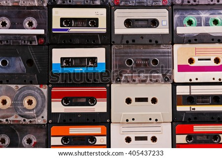 Set of old audio cassettes on wooden background
