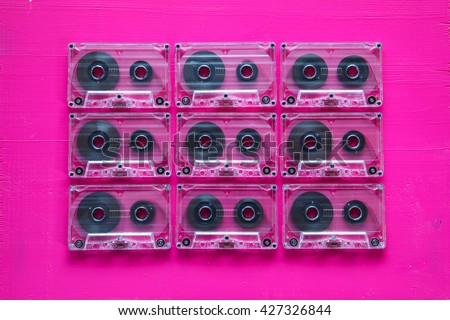 Set of old audio cassettes on wooden table.Retro plastic audio cassette, music cassette, cassette tape.Vintage tape. - stock photo