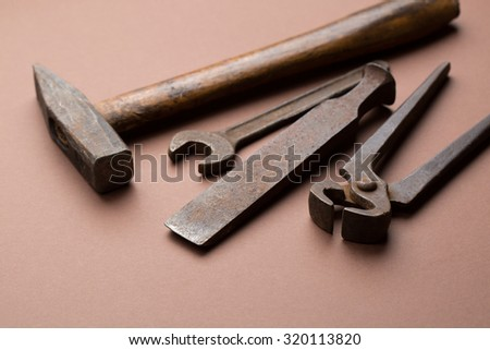 set of old dirty tools on red background - stock photo
