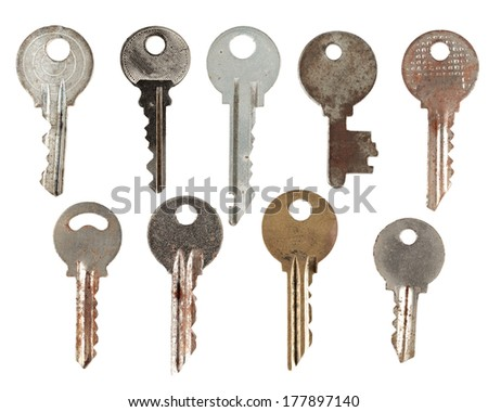 Set of old keys from door locks isolated on white background.