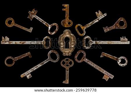 Set of old keys, isolated on black background - stock photo