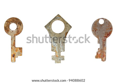 Set of old rusty keys isolated on a white background.