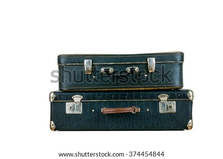 Set of old suitcases. Black retro suitcase. Vintage baggage. Vintage travel bags. - stock photo