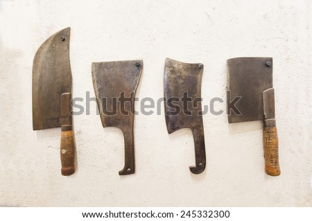 set of old vintage rusty meat cleaver - stock photo