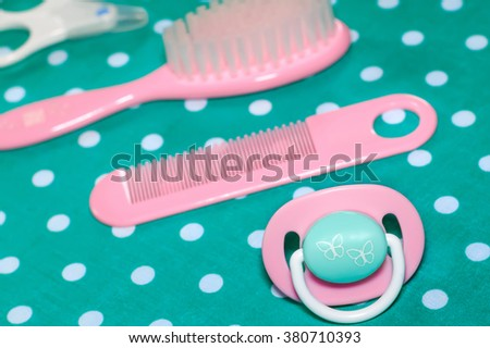 Set of pacifier and brushes for newborn babies