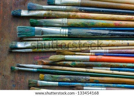 Set of paint brushes on the table - stock photo