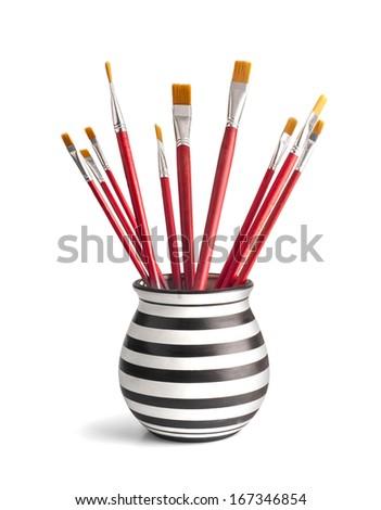Set of paintbrushes in a vase - stock photo