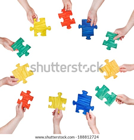 set of painted puzzle pieces in people hands in circle isolated on white background