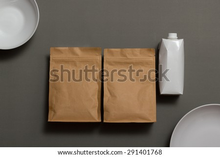 Set of paper bags, bowl, plate, paper box isolated on grey background - stock photo