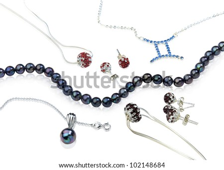 Set of pearl and diamond jewelry - stock photo