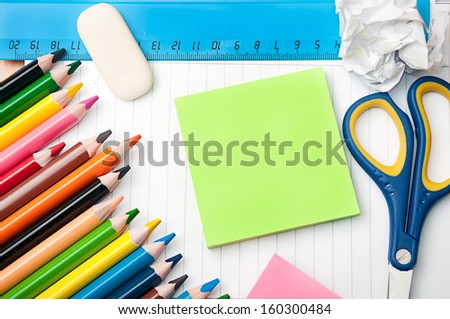 set of pencils, scissors, rubber, ruler and paper - school and office tools - stock photo
