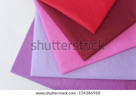 Set of 5 pieces colored felt on white felt background  - stock photo