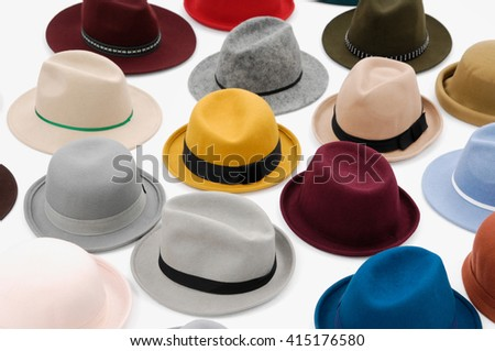 Set of pile of colorful female hat - stock photo