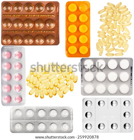 Set of pills in a plastic blister package and some fish oil capsules isolated on white - stock photo