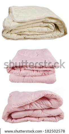 set of pink and beige blankets isolated on white background - stock photo