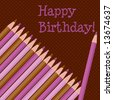 """Set of pink and brown colored pencils at an angle; """"Happy Birthday!"""" text - stock photo"""