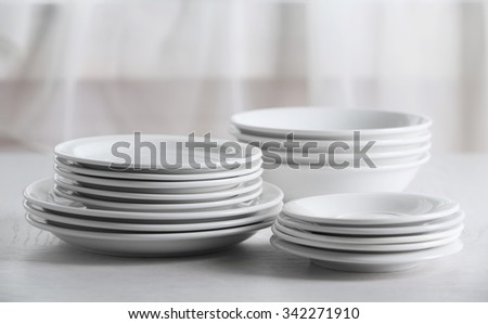 Set of plates on table - stock photo