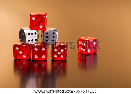 set of playing  dices on reflective table