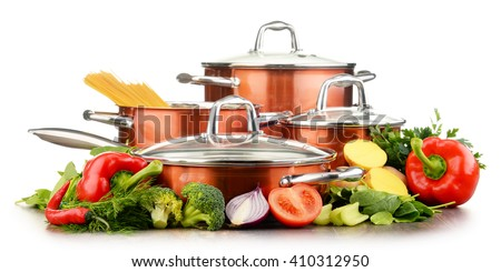 Set of pots and raw vegetables isolated on white background.
