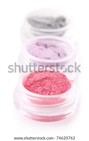Set of powder eye shadows in jars isolated on white background. - stock photo