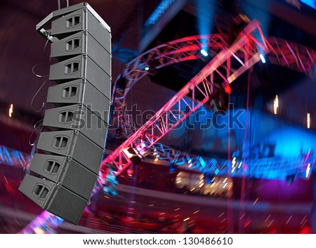 set of powerful speakers with blurred background - stock photo