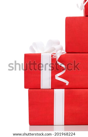 Set of presents wrapped in red paper, isolated on white - stock photo