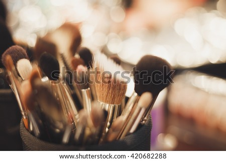 Set of professional brushes for make up. Macro, no models, fading film colors - stock photo