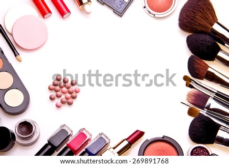 Set of professional cosmetic: make-up brushes, shadows, lipstick, nail polishes - partly isolated with shadows on white background. Overhead view. Front part. Place for your text. - stock photo