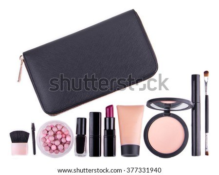 Set of professional cosmetic: make-up mascara, shadows, lipstick, nail polish and purse - partly isolated with shadows on white background. Overhead view. Place for text. - stock photo
