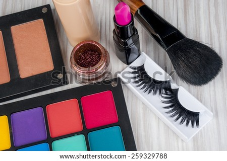 Set of professional makeup and cosmetics. on a light background isolated - stock photo