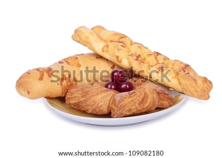 Set of puff pastry on plate. Isolated on white. All in focus