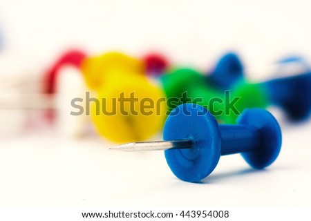 Set of push pins in different colors isolated on white background. - stock photo