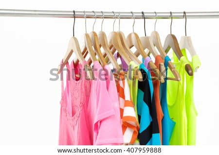 Set of rainbow many peignoir and t-shirt hanging on wooden hangers
