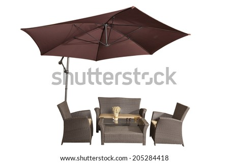 Set of rattan garden furniture under a big garden umbrella isolated on white - stock photo