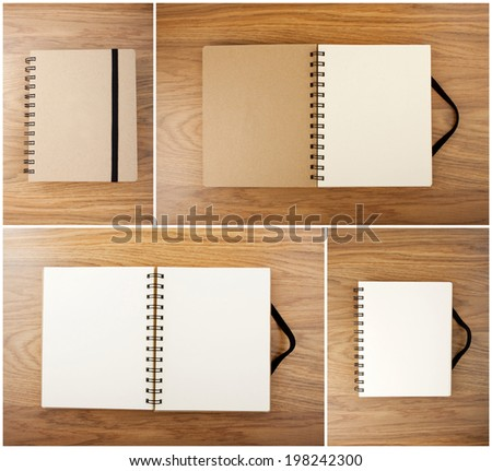 Set of Recycled paper notebook with black elastic band on wooden background - stock photo