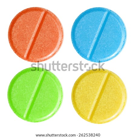 Set of red, blue, green and yellow medical pill tablet isolated on white - stock photo