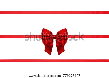 Set of red bow with three ribbons made from silk ribbon isolated on white background