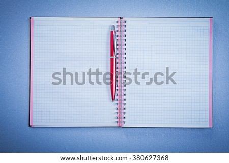 Set of red brio pen blank copybook office concept. - stock photo