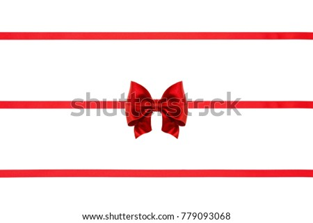 Set of red holiday satin ribbon bows and ribbons isolated on white background