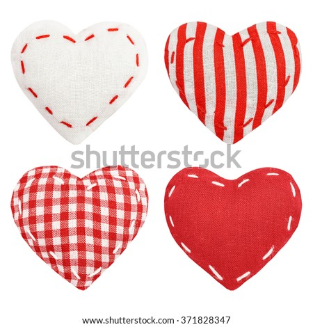 Set of red striped, checkered textile, fabric heart, St. Valentine's Day, close up, isolated on the white