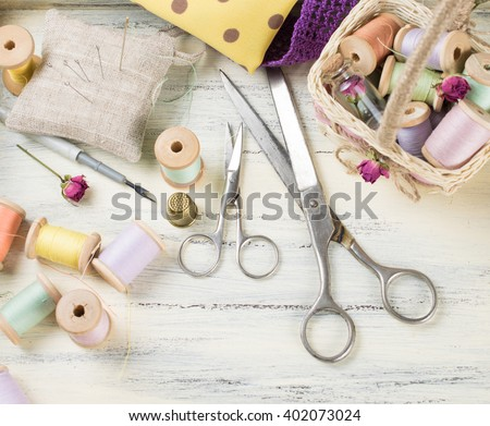 Set of reel of thread, scissors, fabric and pins for sewing and needlework in the style  Shabby chic - stock photo