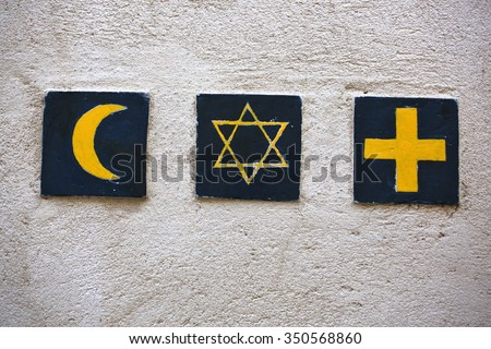 Set of 3 religious symbols: islamic crescent, jewish David's star, christian cross (wall sign on the street of Segovia, Spain)   - stock photo