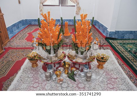 Set of rice offering from flower and banana leaf on silver bowl with rice egg and food object for respect for  wrist-binding ceremony,  Laos Wedding Decorate - stock photo