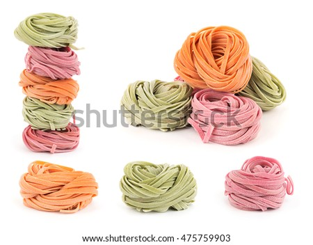 Set of rolled colorful fresh fettuccine Italian pasta isolated on white